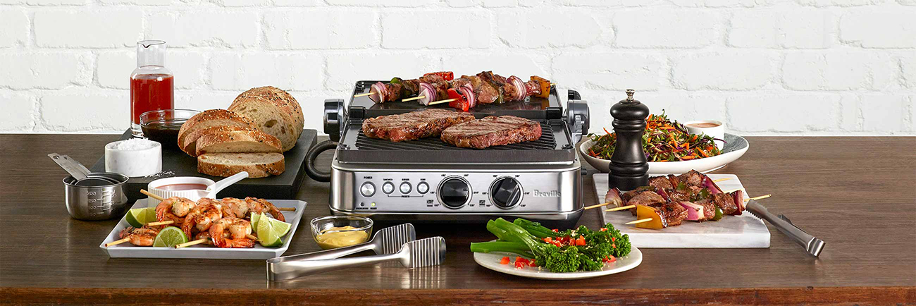 the Sear & Press™ Grill in brushed stainless steel