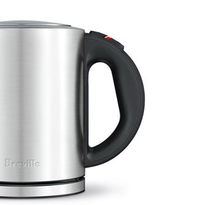 the Compact Kettle™ Tea In Brushed Stainless Steel ergonomic handle