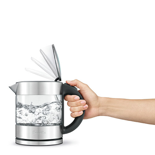 the Compact Kettle™ Clear Tea In Silver ergonomic handle