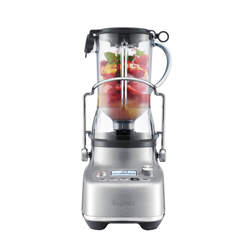 Blending fruits to create a smoothie.
