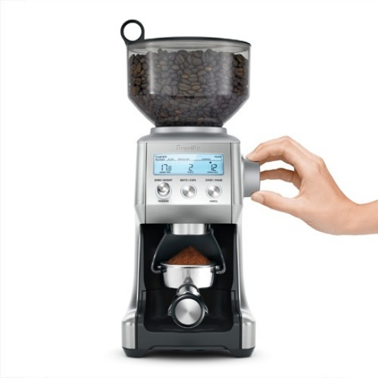 the Smart Grinder Pro Coffee Grinder in Stainless Steel grinds directly onto portafilter