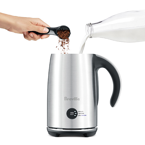 the Hot Choc & Froth Milk Frothing Machine in Brushed Stainless Steel automatically aerates chocolate shavings