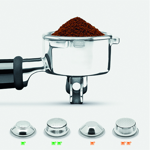 Coffee beans being poured into the integrated coffee grinder.