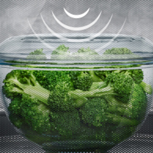 Bowl of Broccoli steaming in the microwave.