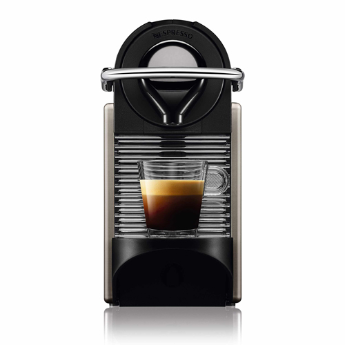 Front view of the Pixie Nespresso machine with a shot of espresso.