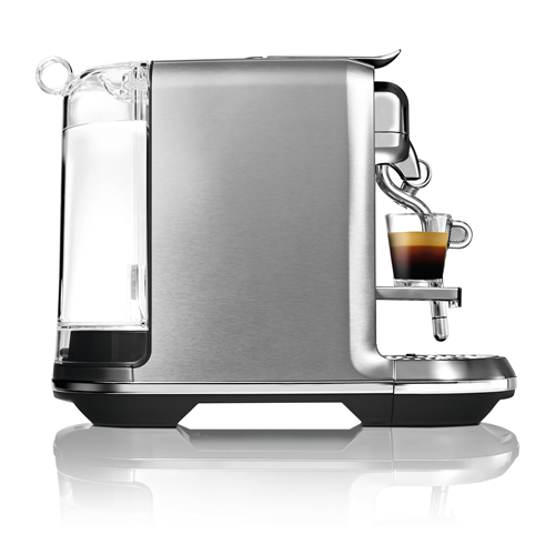 Side view of machine with espresso with latte on top.