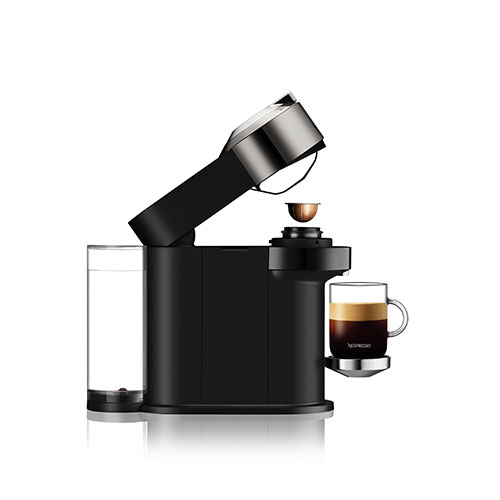 Side view of the machine with black coffee and capsule