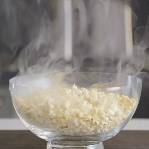 Bowl of popcorn infused with cold smoke.